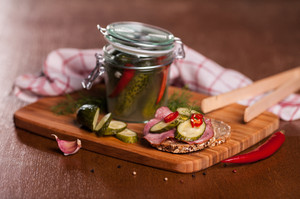 Close up of sandwich with homemade pickled cucumbers
