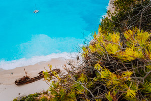 Close up of Shipwreck in Navagio beach. Azure turquoise sea water and paradise sandy beach. Famous tourist visiting landmark on Zakynthos island, Greece