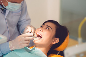 Close-up of Vietnamese woman having her teeth examined by specialist