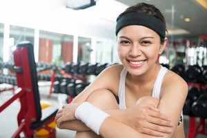 Close-up portrait of a cheerful fit woman during the break between workouts