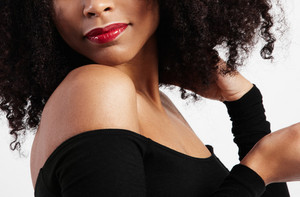closeup of black woman lips with glossy red lipstick