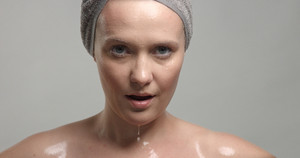 closeup of woman's face with wet skin with drops of water on it. Mousturizing skin concept