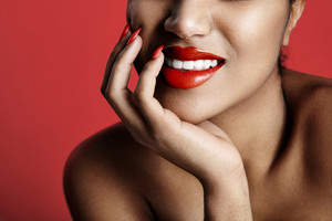 closeup photo of woman's lips colored by red