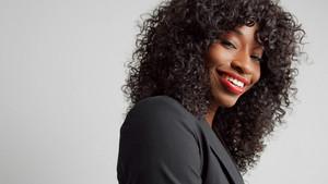 closeup portrait of office black mixed race businesswoman smiling