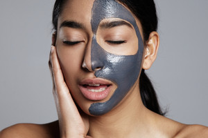 closeup portrait of woman feeling pleasure during facial mask treatment