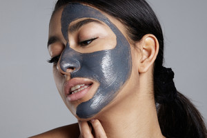closeup portrait of woman with facial mask