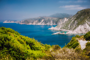 Coastline near Agia Eleni and Pitani beach in Kefalonia Island, Greece. Most beautiful rocky wild beaches with clear emerald water and high white limestone cliffs landscape