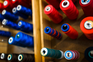Collection of threads on spools in tailoring-shop