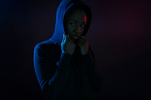 Colorful portrait of a cool black woman with dark skin wearing hoodie