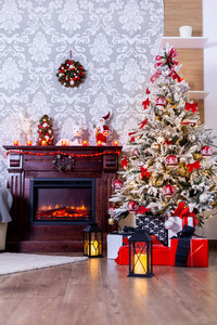 Colorful presents under Christmas tree in decorated room. The joy of Christmas.