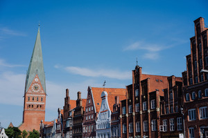 Colorful traditional facades in the old historic market square with church in Luneburg, Germany