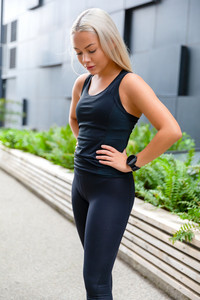 Confident Attractive Athletic Woman Standing Against Building In City