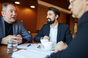 Confident businessmen discsussing ideas for start-up
