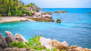 Costline of Koh Tao Islands in Thailand. Granite Rocks and blue lagoon with clear sea water