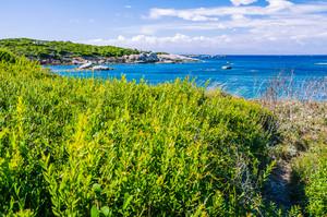 Costline with granite rocks and amazing azure water on Porto Pollo, Sardinia, Italy