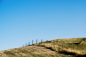 Country Fence with clear blue sky