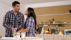 Couple cooking together in the kitchen at home. Healthy food