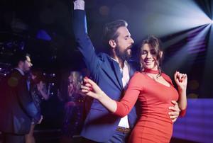 Couple flirting at night club