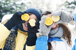 Couple have fun with natural vitamins in winter