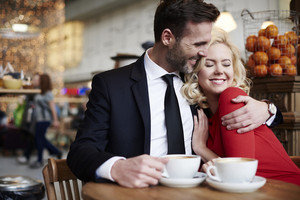 Couple hugging in the coffee bar