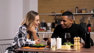 Couple making their conection even stronger while having a romantic dinner. Feeling loved.