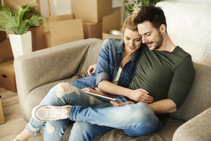 Couple sitting on the sofa in their new place