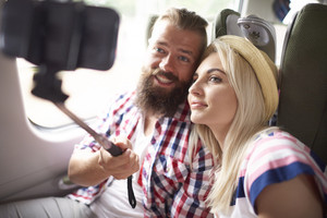 Couple taking selfie in the train