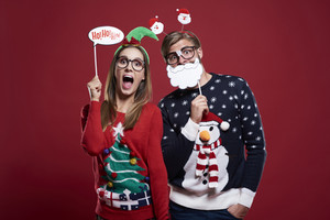 Couple with funny christmas masks