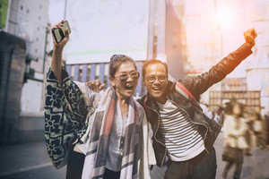 couples of asian traveller happiness emotion at dotonbori most popular traveling destination in osaka japan