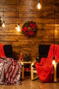 Cozy Christmas chiars in beautiful home beautiful Christmas lights. Magic Atmosphere