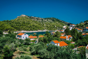 Cozy town, relaxing, summer feeling. Red roofs of Assos village at the lush green Mediterranean place of Kefalonia Island