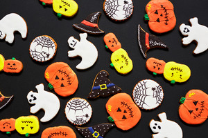 Creative background made up of Halloween biscuits