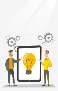 Creative business team brainstorming. Two businessmen during brainstorming session pointing finger at light bulb on tablet. Brainstorming concept. Vector flat design illustration. Vertical layout.