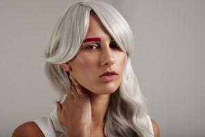 creative coloured hair of model. grey hair pink brows