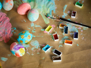 Creative Easter background with watercolors and painted eggs