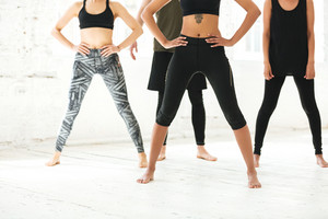 Cropped image of a mixed group of people exercising together in a gym