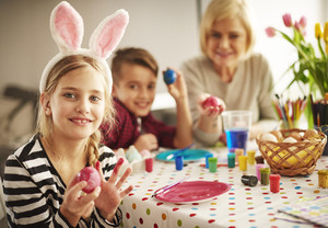 Cute blond hair girl with Easter decorations