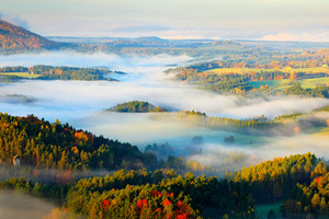 Czech typical autumn landscape. Hills and villages with foggy morning. Morning fall valley of Bohemian Switzerland park. Hills with fog, landscape of Czech Republic, Ceske Svycarsko, wild Europe.