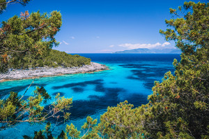 Dafnoudi beach in Kefalonia, Greece. Fascinating clean turquoise sea water color. Stunning charming famous places. Vacation recreation concept