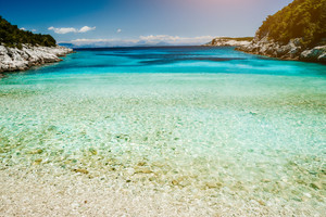 Dafnoudi beach in Kefalonia, Greece. Remote lagoon with pure clean turquoise sea water, white rocks and cypress trees