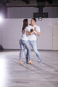 Dancing class witnesses the passion of kizomba partners. Latino elegance.