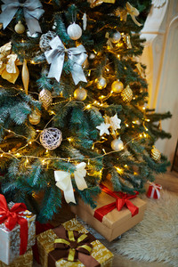 Decorated firtree and xmas gifts