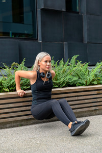 Dedicated Woman Doing Triceps Dips Outdoor in the City