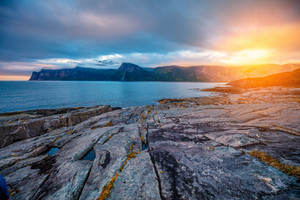 Deserted rocky beach at sunset. Senja island, Norway