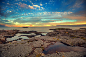 Deserted rocky beach at sunset