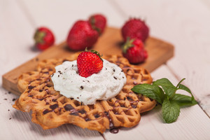 Dessert from waffles with cream and fruits