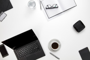 Devices And Office Supplies On White Desk