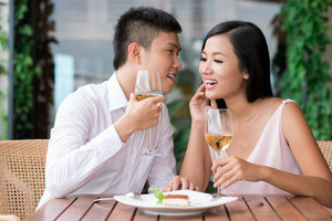 Dining couple being excited about the secret they share