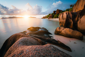 Dreamy sunset at the gorgeous exotic Anse Source d'Argent beach, La Digue island, Seychelles. Long exposure panorama