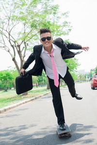 Dynamic image of a skateboarding businessman